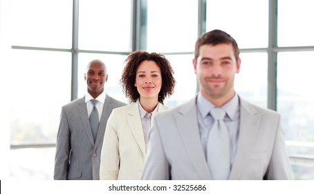 Attractive businesswoman in a line with her colleagues