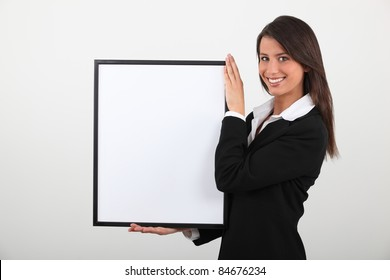 Attractive businesswoman with picture frame