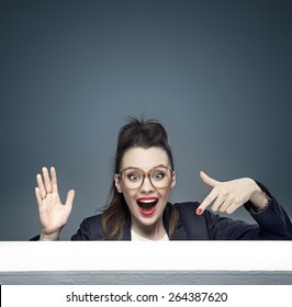 attractive businesswoman pointing something on a table