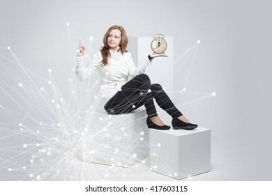 Attractive businesswoman showing clock