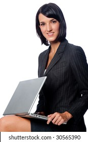 An attractive businesswoman sitting down with a laptop on white background