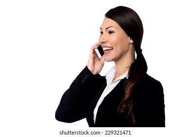 Attractive businesswoman using cell phone over white