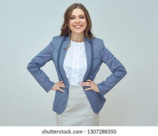 Attractive businesswoman wearing business suit. Smilng woman with long hair.