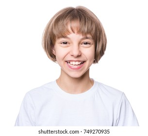 Attractive caucasian girl, isolated on white background. Schoolgirl smiling and looking at camera. Happy child in white t-shirt - emotional portrait close-up.