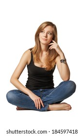 Attractive caucasian girl sitting on floor over white background