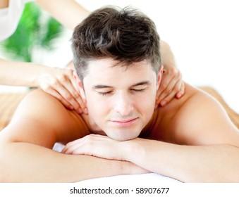 Attractive caucasian man having a back massage in a spa center