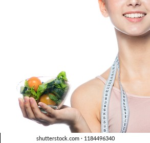 attractive caucasian smiling woman isolated on white studio shot holding salad diet fitness slim body care