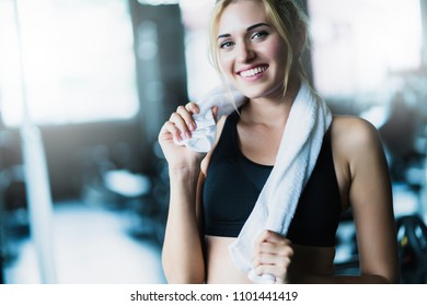 attractive caucasian woman relax after workout with happiness and joyful in gym healthy ideas concept