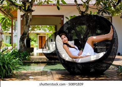 An attractive caucasian woman relaxing and lounging outdoors