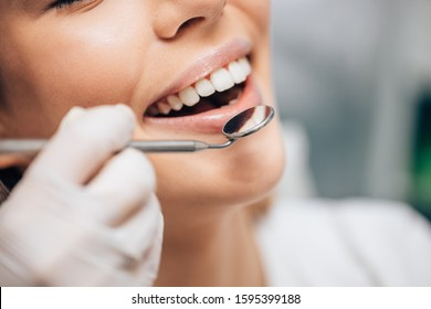 attractive caucasian woman visiting dentist, doctor doing dental examination before treatment, ideal teeth