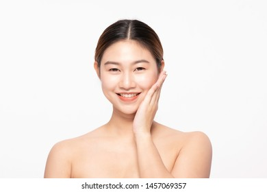 Attractive Charming Asian young woman smile with white teeth and touching soft cheek feeling so happy and cheerful with healthy Clean and Fresh Skin,isolated on white,Beauty Cosmetology Concept