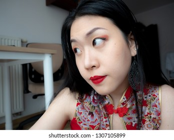Attractive Cheerful asian young smiling Chinese woman wear qipao for Chinese new year day with attractive smile,
