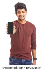 Attractive cheerful young man showing smartphone against white.