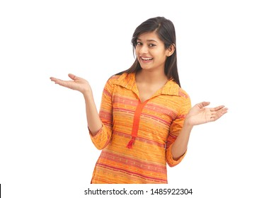 Attractive cheerful young women greetings on white
