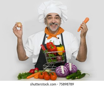 attractive  chef and shopping cart with fresh vegetables