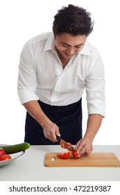 An attractive chef wearing a white shirt and black apron preparing a healthy meal in front of a white background.