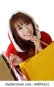 Attractive Christmas girl shopping and holding bags.