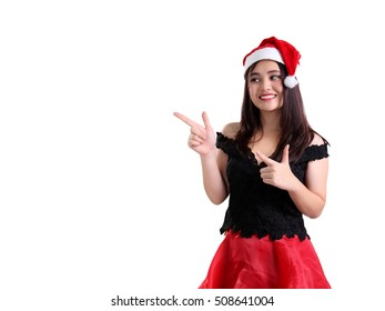 Attractive Christmas lady with both hands' fingers pointed like guns to copy space on white, gesturing recommendation of what things to buy on Year End sale