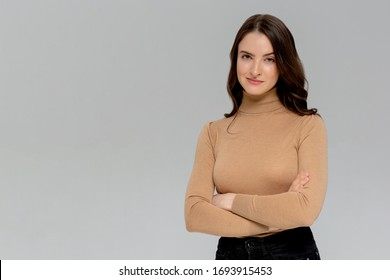 Attractive confident creative good-looking female bossy employee cross arms chest self-assured pose smiling assertive ready accomplish goals feeling lucky standing monochromatic background