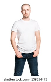 Attractive confident man in white t-shirt and blue jeans isolated on white