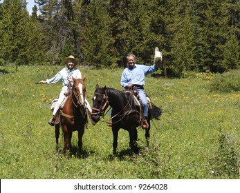 Attractive Corporate Couple Riding Horses in Jackson Hole, Wyoming