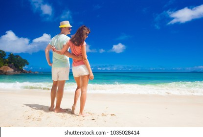 attractive couple enjoying sunny day at Maia Beach. Mahe, Seychelles