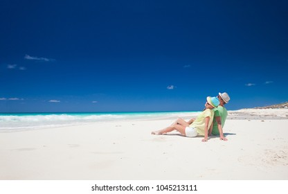 attractive couple enjoying sunny day at Cayo Largo beach, Cuba
