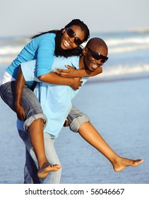 Attractive couple having fun together at the beach