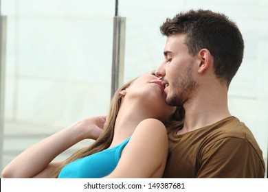 Attractive couple kissing with love and passion outside