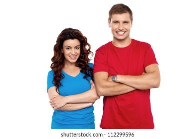 Attractive couple posing with arms crossed in front of camera