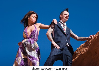 Attractive couple posing in fashionable dresses