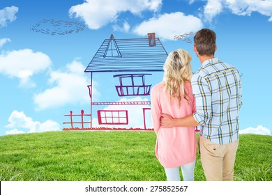 Attractive couple standing and looking against blue sky over green field