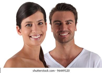 Attractive couple stood in studio