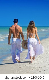attractive couple walking at the beach