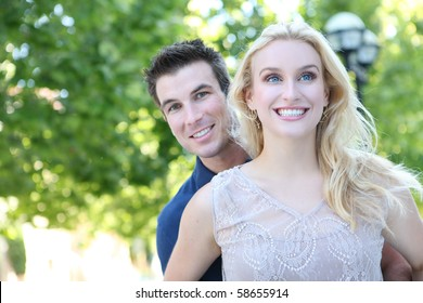 A attractive couple - woman and handsome man in love in the park
