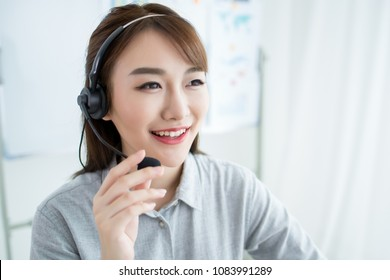 Attractive customer servicer working in office