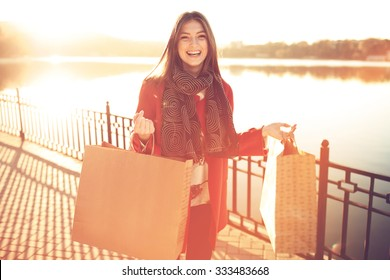 Attractive cute girl in with the shopping bags in her hands