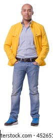 Attractive cutout man character holding both hands in pockets. Isolated over white background. Full length portrait.