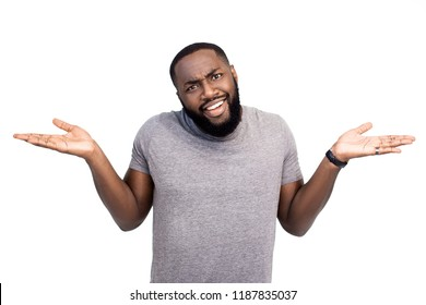Attractive dark skinned amazed male businessman has discontent expression, doesn`t agree with mark, argues with collegues, isolated on white background. Emotional African American hipster guy indoor