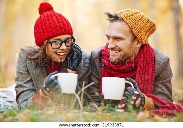 Attractive dates with tea or coffee relaxing in natural environment