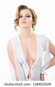 Attractive decollete with breasts. Woman wear dress with deep decollete. Girl curly hairstyle wear dress with decollete white background. Seductive decollete concept.