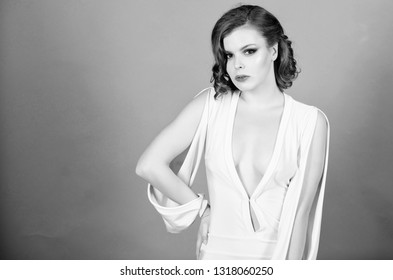 Attractive decollete with breasts. Woman wear dress with deep decollete. Seductive decollete concept. Girl makeup and vintage hairstyle wear dress with decollete. Lady attractive sexy model.