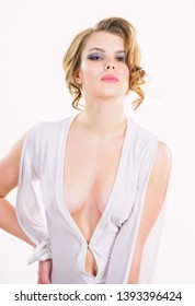 Attractive decollete with breasts. Woman wear dress with deep decollete. Girl curly hairstyle wear dress with decollete white background. Seductive decollete concept. Lady attractive sexy model.