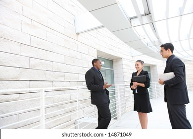 An attractive, diverse business team meeting as a group