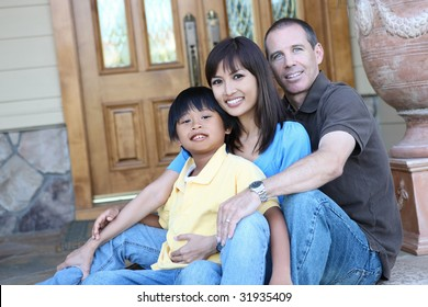 Attractive diverse family outside their home on porch