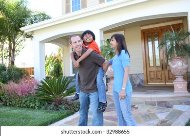 Attractive diverse family outside their home having fun