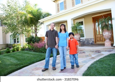 Attractive diverse happy family outside their home