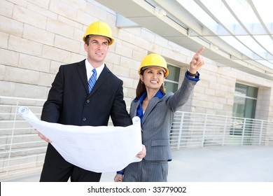 An attractive, diverse man and woman construction team at building site