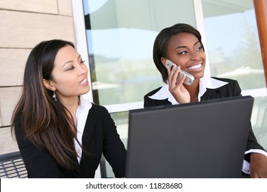 An attractive, diverse women business team at the office