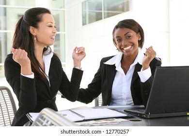 An attractive, diverse women business team working on computer